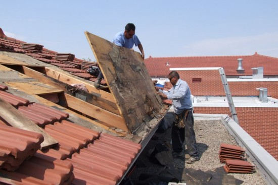 Removing a section of the damaged roof deck.